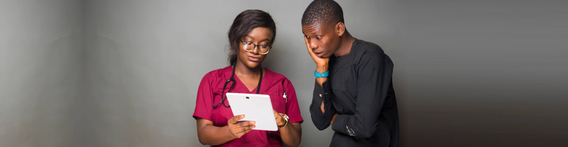 nurse showing her tablet to her patient